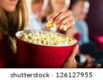 woman eating large container of ... | Shutterstock . vector #126127955