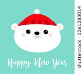 Happy New Year. Polar white bear cub face round icon. Red hat. Merry Christmas. Cute cartoon baby character. Arctic animal. Hello winter. Flat design. Hello winter. Blue background Vector illustration
