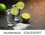tequila shot with lime and salt ... | Shutterstock . vector #1261310197