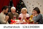 traditional family praying...   Shutterstock . vector #1261340884