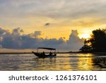fisherman and boat during... | Shutterstock . vector #1261376101
