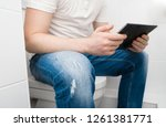 man using tablet pc in the... | Shutterstock . vector #1261381771