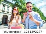 beautiful young couple enjoying ... | Shutterstock . vector #1261392277