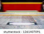 blurred red subway train ... | Shutterstock . vector #1261407091