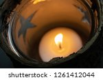 tealight in a cup with stars | Shutterstock . vector #1261412044