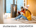 young couple dressed in bright... | Shutterstock . vector #1261434934