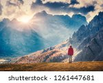 young woman on the hill is... | Shutterstock . vector #1261447681