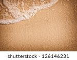 closeup of sand and small wave | Shutterstock . vector #126146231