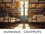 Small photo of Empty room with twin beds. Metal bed hostel with minimalistic decoration.