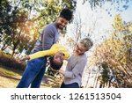 happy young mixed race couple... | Shutterstock . vector #1261513504