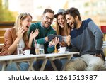group of four friends having a... | Shutterstock . vector #1261513987