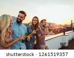 cropped shot of a group of... | Shutterstock . vector #1261519357