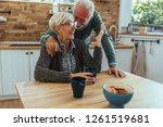 shot of a mature man hugging...   Shutterstock . vector #1261519681