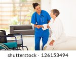 young female caregiver helping... | Shutterstock . vector #126153494