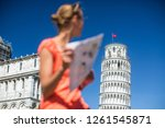 gorgeous female tourist with... | Shutterstock . vector #1261545871