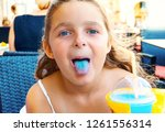 playful happy little girl... | Shutterstock . vector #1261556314