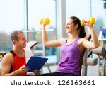 personal trainer explaining an... | Shutterstock . vector #126163661