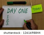 text sign showing day one.... | Shutterstock . vector #1261698844