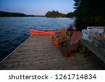 chairs on a cottage wooden dock ... | Shutterstock . vector #1261714834
