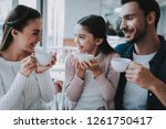 young family resting in cafe.... | Shutterstock . vector #1261750417
