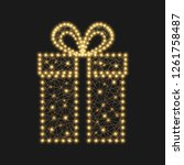 bright shiny gift on a black... | Shutterstock . vector #1261758487