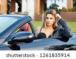 hot sexy blonde in a red skirt... | Shutterstock . vector #1261835914