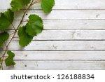 vine leaves on a white wooden...   Shutterstock . vector #126188834