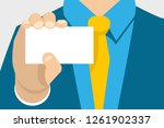 hand with a business card close ... | Shutterstock .eps vector #1261902337