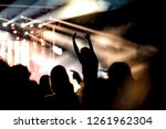 cheering crowd with raised... | Shutterstock . vector #1261962304