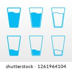 full and empty glass of water... | Shutterstock .eps vector #1261964104