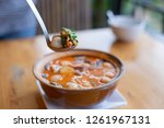 tom yum kung on spoon selective ... | Shutterstock . vector #1261967131
