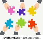 image of puzzle in 6 hands | Shutterstock .eps vector #1262013901