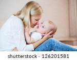 mother playing with baby boy... | Shutterstock . vector #126201581