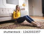 teenage girl sitting on the... | Shutterstock . vector #1262032357