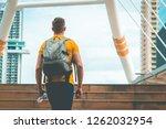 male sport man is walking up... | Shutterstock . vector #1262032954
