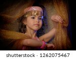 little girl in oriental costume. | Shutterstock . vector #1262075467