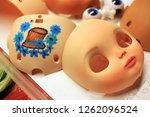 making doll face | Shutterstock . vector #1262096524