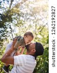 man father bonding with son... | Shutterstock . vector #1262192827