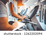 coach and client at the gym | Shutterstock . vector #1262202094