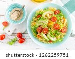 pasta salad with avocado  fresh ... | Shutterstock . vector #1262259751