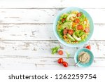 pasta salad with avocado  fresh ... | Shutterstock . vector #1262259754