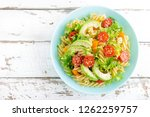 pasta salad with avocado  fresh ... | Shutterstock . vector #1262259757