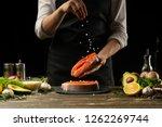 the chef prepares fresh salmon... | Shutterstock . vector #1262269744