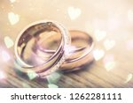engagement rings on background... | Shutterstock . vector #1262281111