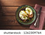 poached eggs on baguette with... | Shutterstock . vector #1262309764