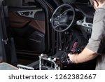a mechanic repairs a luxury suv ... | Shutterstock . vector #1262382667