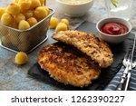 wiener schnitzel with potato... | Shutterstock . vector #1262390227