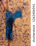 blue letter painted on rusty...   Shutterstock . vector #1262406541