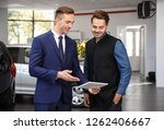 young car salesman working with ... | Shutterstock . vector #1262406667