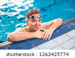 male swimmer in an indoor... | Shutterstock . vector #1262425774